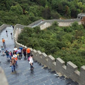 "Pic shows: Visitors in the copycat version of the great Wall of China.  With tourists now so crowded on the great Wall of China that they were moving no more than 10 m every five minutes, it's no surprise that this copycat version of the real thing is now proving a huge success.  Despite its size the real great Wall of China now attracts so many visitors, the people spend hours waiting in queues to get onto the structure and then hours more to walk along it and get back off again.  Many complain that it ruins the experience, and as a result this copycat version which looks exactly like the real thing and is located in the impressive scenery of a national park proved a winner over the recent week-long holiday.  Although considerably shorter than the real thing, it is nevertheless built to scale and was commissioned by the government of Nanchang, capital of east China's Jiangxi Province.  Located in the Nanchang Ecological Park it gives visitors the chance to walk along 4 km of structure which looks exactly like the real thing.  In fact, tourists visiting the copycat version of the famous 2,200-year-old structure said they found it hard to tell it apart, despite the fact that the Nanchang version was made with modern-day materials.  And they also manage to walk along with a lot more ease than on the original version where tens of thousands were gathered.  Ironically when it was unveiled tourism chiefs tried to play down the fact that it was a copy of the great wall is actually called it the scenic corridor.  But local media who were impressed by the idea quickly gave up on that idea and started referring to it as the Great Wall copy.  Project organiser Chen Kui said: ""It was built as a place where locals can come and exercise without having to travel too far from their homes.""  The original Great Wall was built by soldiers during the Warring States Period (475–221) of Chinese history to protect the country against the various nomadic groups of the Eurasian Steppe.  (ends)"